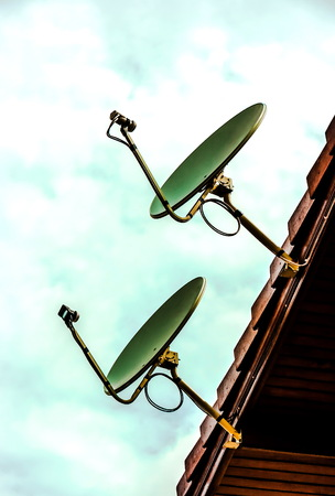 dish disk: Satellite pair on the roof