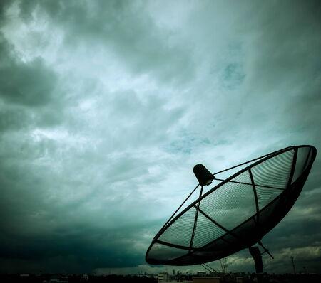 nimbus: satellite dish and nimbus in the sky