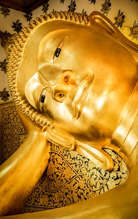 looked: Buddha with armrest looked peaceful Stock Photo