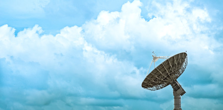 look for: Large satellite dish with beautiful clouds look for beauty