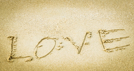 wrote: Somebody wrote love letters in the sand Stock Photo