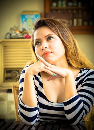 Beautiful girl thinking for someone Standard-Bild