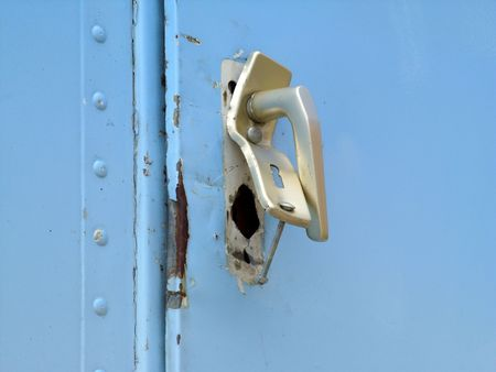 Destroyed door lock caused by vandalism or housebreaking Stock Photo