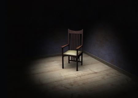 暗い部屋で古い椅子 写真素材