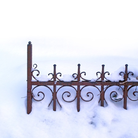 old rusty fence in the snow photo