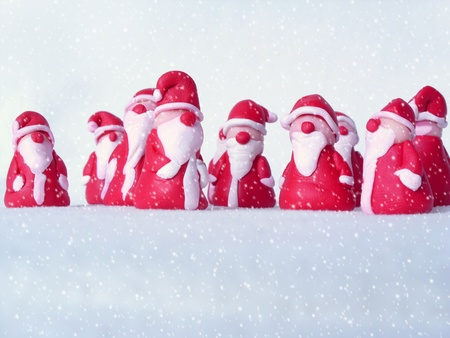 tinkered: a group of santas in the snow Stock Photo