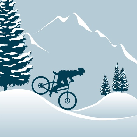 man hiking: riding a mountain bike in the snowy mountains