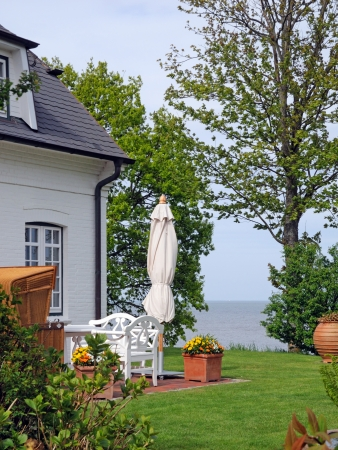 vacation home: seaside garden with beautiful view Stock Photo