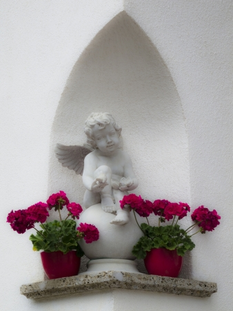 neo gothic: an angel putto in an alcove Stock Photo