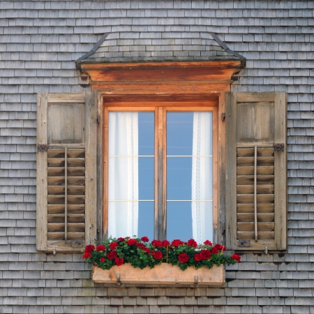 ancient window in wooden timber facade photo