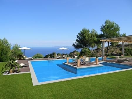 fiktiven Schwimmbad mit einer kleinen Insel in der Mitte und einem schönen Blick auf das Meer - Rendering Lizenzfreie Bilder