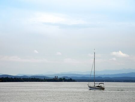 friedrichshafen: sailing boat on its way home on lake constance                           Stock Photo