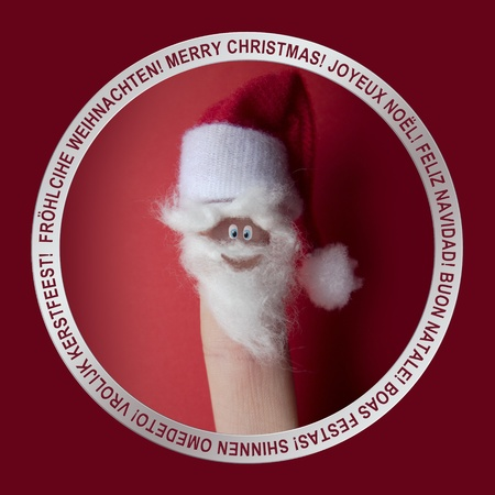 ring finger: christmass greetings icon with a finger dressed as Santa Claus