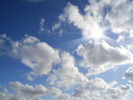 oxygene: sun with sunbeams in a beautiful cloudy sky