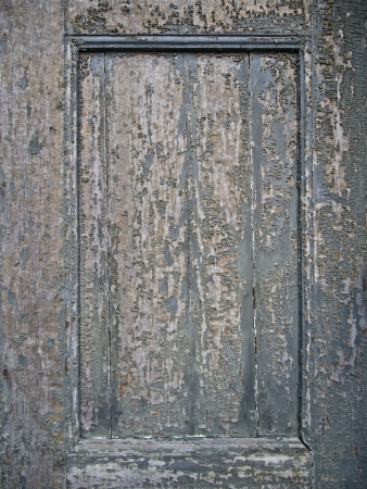 old weathered wooden background with cracked lacquer photo