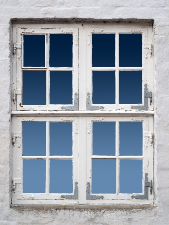 renovate old building facade: old white wooden danish window Stock Photo