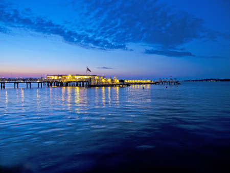 schleswig holstein: a pier and bathhouse by night in kiel