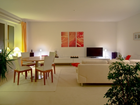 modern living and dining room by night