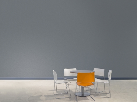 chairs and a table in front of a gray wall with space to paste your own images Foto de archivo