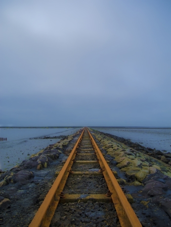 daunting: a lonesome old and rusty rail in the dawn