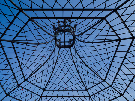 statics: ancient iron roof construction of a garden pavilion Stock Photo