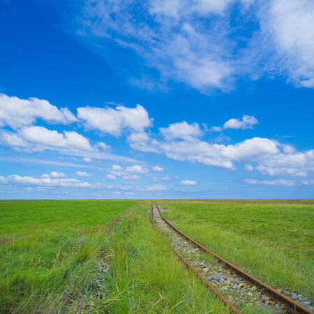 ancient rail track leading to the endless nothing photo