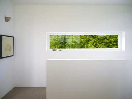 modern rectangular white wooden window with view to the garden photo