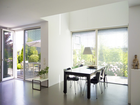 balcony window: modern dining room interior with view to garden