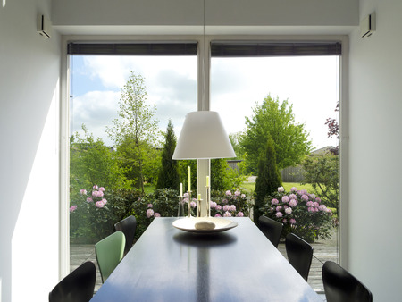 french doors: modern dining room with view to the garden