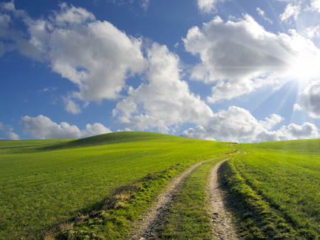 lonesome: winding path through lonesome rural landscape Stock Photo