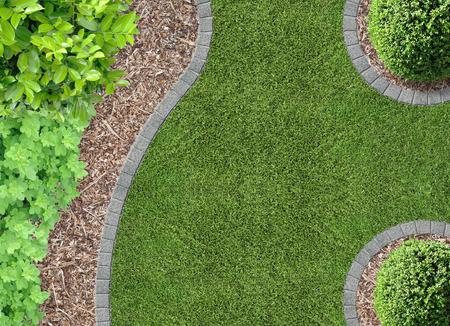 Garden detail in aerial view with bark compost Foto de archivo