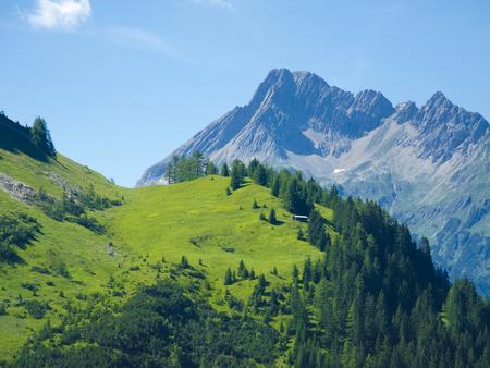 wooden hut: wooden hut and impressing alpine mountain panorama Stock Photo