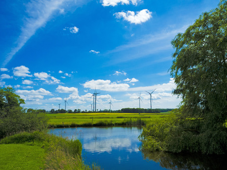 agrarian: agrarian landscape with wind farm and pond