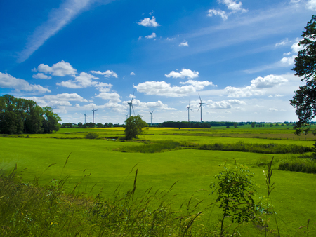 agrarian: wind farm in agrarian landscape with meadows Stock Photo