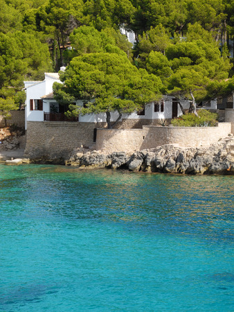 mediterranean home: white home in a small bay somewhere in a mediterranean country