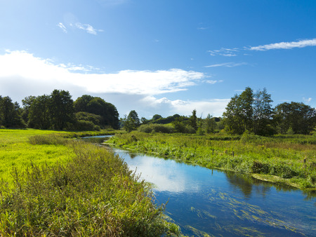 pastures: small river winding through natural countryside landscape