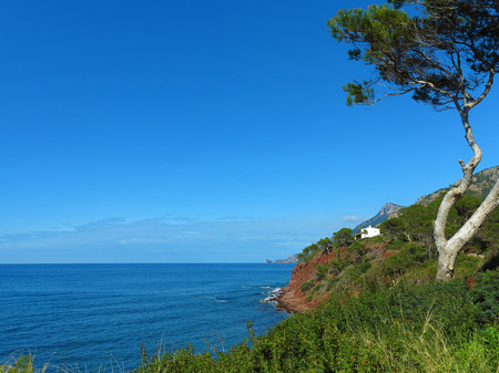 sea cliff: lonesome house in the cliff coast with a view to the sea