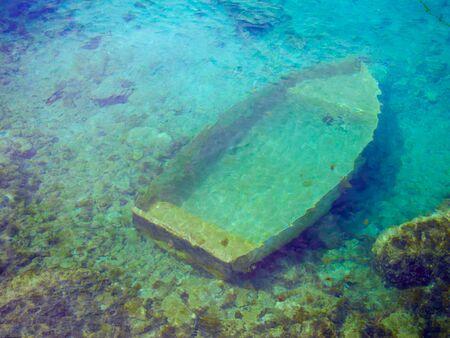 sunken: sunken wreck of a boat in the sea Stock Photo