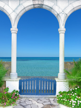 romantic beach: FICTITIOUS vintage style archway with view to the sea Stock Photo