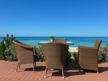 garden furniture suite on terrace with a view to the sea Stock fotó