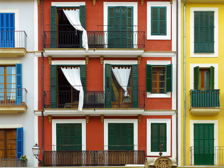 fronts: colorful vintage mediterranean urban house fronts in Palma, Majorca, Balearic Islands, Spain
