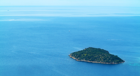 lonesome: lonesome little island in the middle of the see in aerial view
