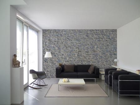 Woonkamer met natuurstenen muur en copyspace voor uw eigen afbeeldingen