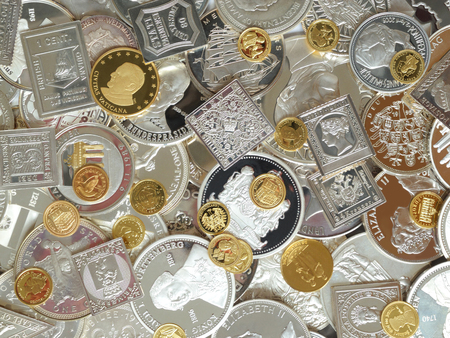 argentum: coins, medals ans stamps of pure silver and gold background