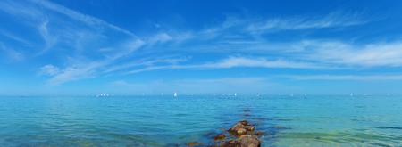 seaside panorama with clear baltic sea and sailing boats