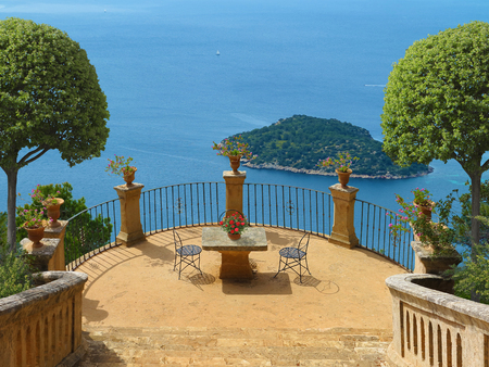 Summer Holidays on a terrace in mediterranean landscape overlooking the sea Stock fotó