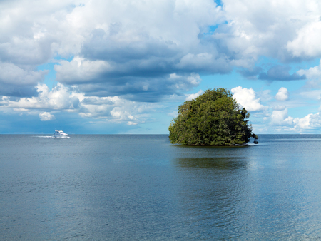 dream vacation with a motor yacht on its way to a deserted island in the middle of the sea Stock fotó