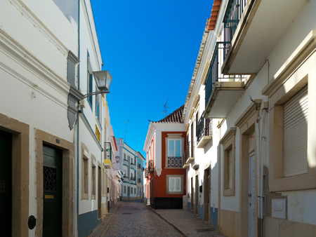 cobblestone lane leading through old townhouses in the center of the historic village Stock fotó