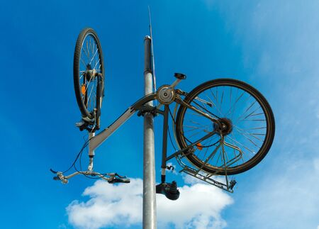 funny bicycle hanging upside down from a traffic sign Stock fotó
