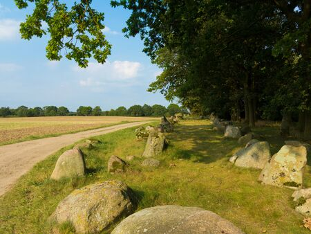 rural agricultural landscape with archaeologically interesting megalithic tomb in northern germany form 2800 before Christ
